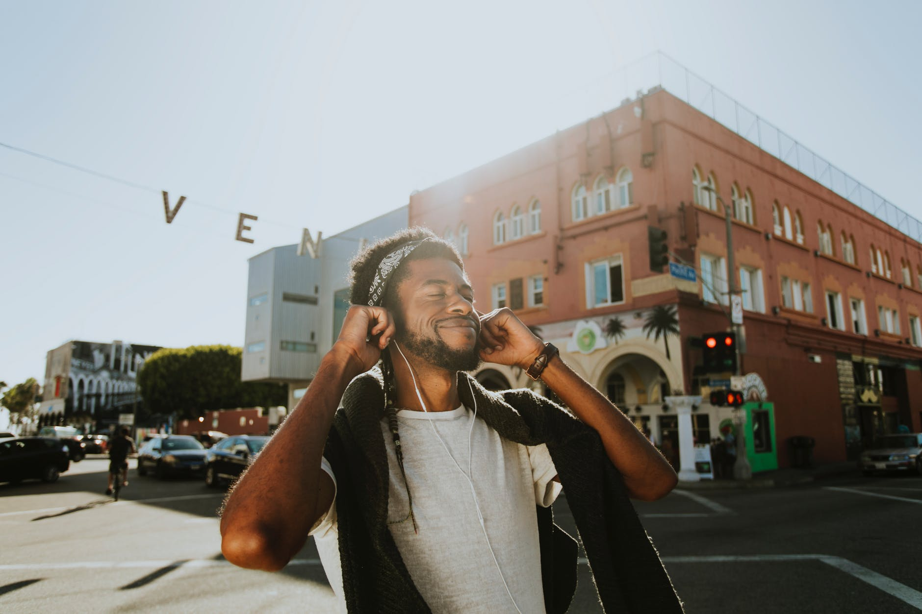 man smiling while listening to music