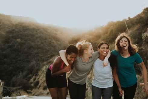 four women standing on mountain