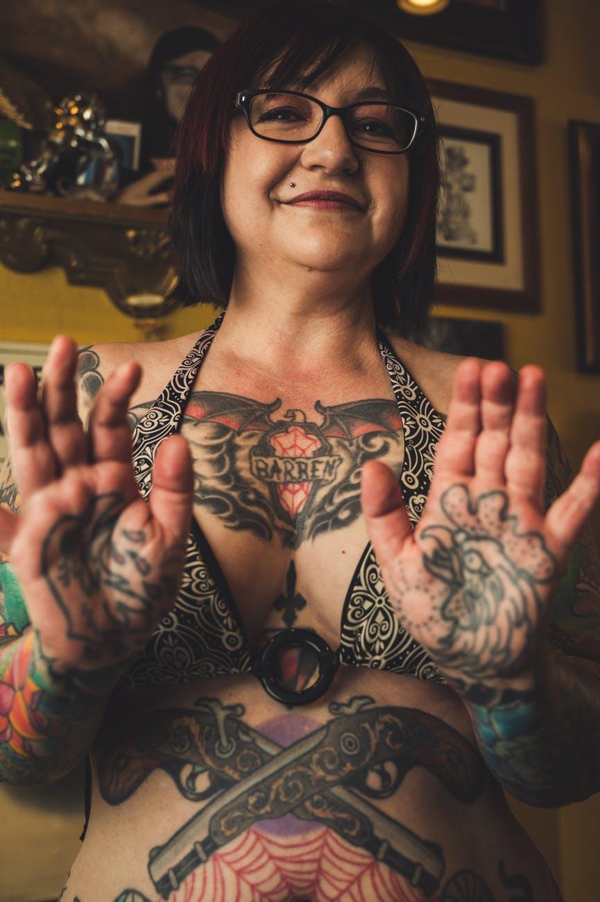 woman showing body tattoo